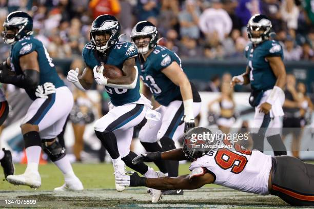 Miles Sanders of the Philadelphia Eagles rushes the ball past William Gholston of the Tampa Bay Buccaneers at Lincoln Financial Field on October 14,...