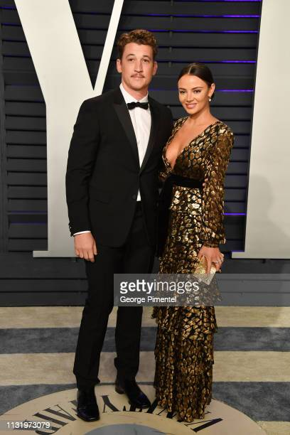 Miles Teller and Keleigh Sperry attend the 2019 Vanity Fair Oscar Party hosted by Radhika Jones at Wallis Annenberg Center for the Performing Arts on...