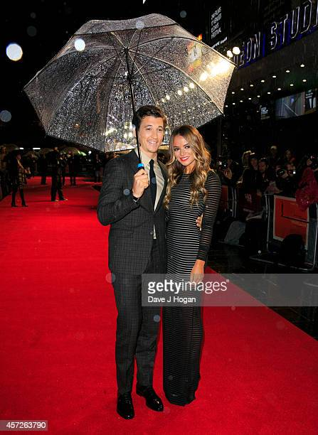 Miles Teller and Keleigh Sperry attends the Accenture Gala premiere for 'Whiplash' during the 58th BFI London Film Festival at Odeon Leicester Square...