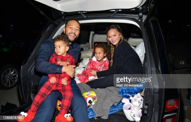 "Miles Theodore Stephens, John Legend, Luna Simone Stephens, and Chrissy Teigen attend Netflix's ""Jingle Jangle: A Christmas Journey"" drive-in..."