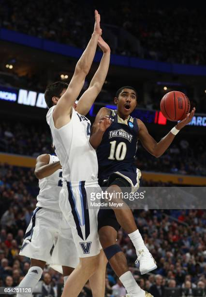 Miles Wilson of the Mount St Mary's Mountaineers goes up to shoot against Dylan Painter of the Villanova Wildcats in the second half during the first...