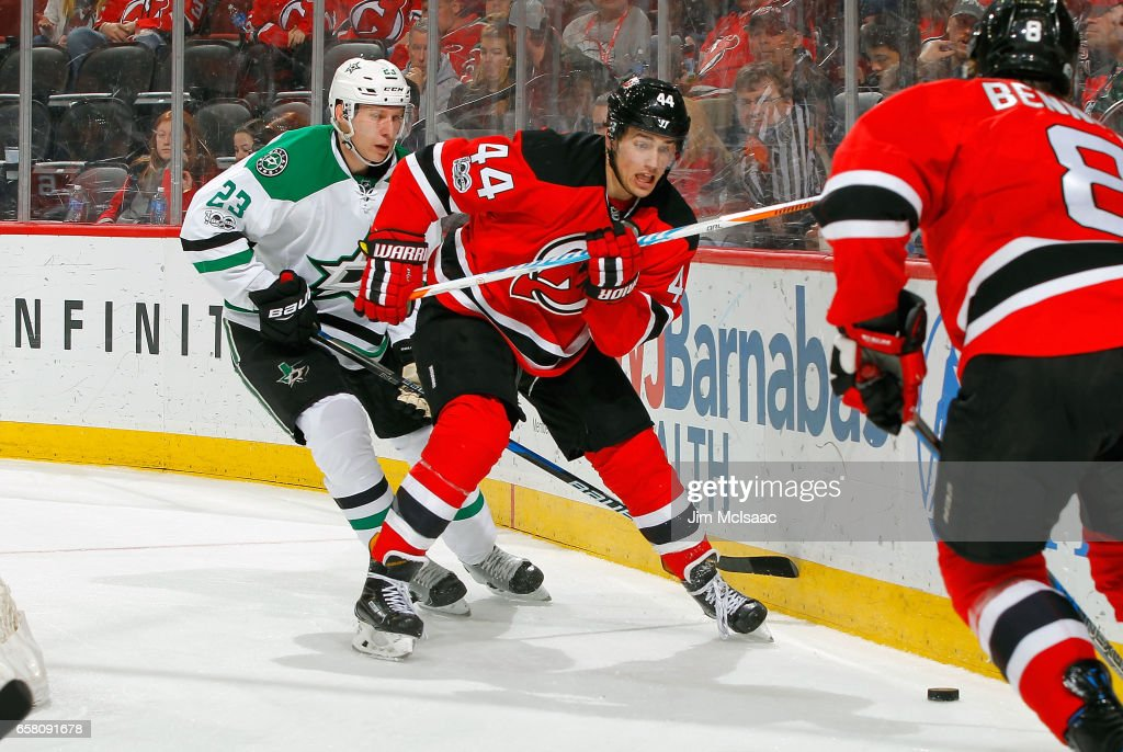 Miles Wood #44 of the New Jersey Devils and Esa Lindell #23 of the Dallas Stars battle for position during the game on March 26, 2017 at Prudential Center in Newark, New Jersey.
