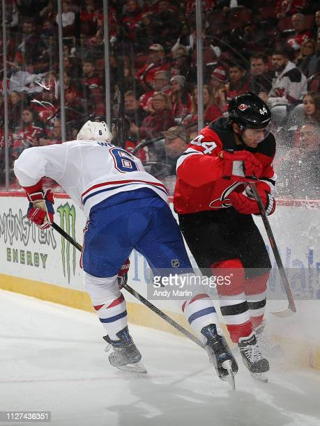 Miles Wood of the New Jersey Devils and Shea Weber of the Montreal Canadiens collide during the first period at the Prudential Center on February 25,...