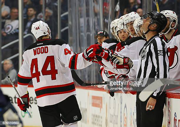 Miles Wood of the New Jersey Devils celebrates his first career NHL goal against the Winnipeg Jets during third period action at the MTS Centre on...