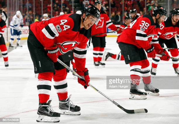 Miles Wood of the New Jersey Devils during warm ups prior to taking on the Tampa Bay Lightning at the Prudential Center on October 17 2017 in Newark...
