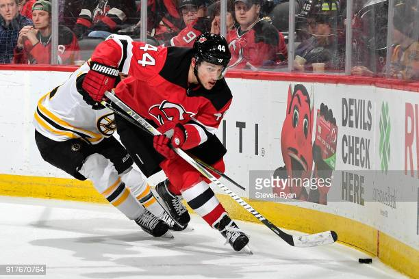 Miles Wood of the New Jersey Devils in action against the Boston Bruins at Prudential Center on February 11 2018 in Newark New Jersey The Boston...