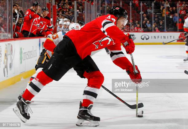 Miles Wood of the New Jersey Devils in action against the Calgary Flames on February 8 2018 at Prudential Center in Newark New Jersey The Flames...