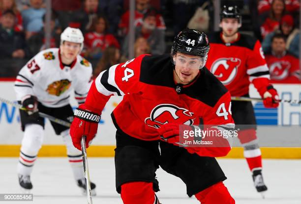 Miles Wood of the New Jersey Devils in action against the Chicago Blackhawks on December 23 2017 at Prudential Center in Newark New Jersey The Devils...