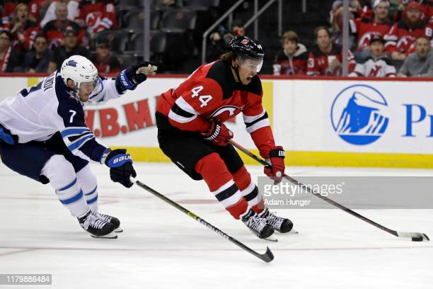 Miles Wood of the New Jersey Devils in action against the Winnipeg Jets during the second period at the Prudential Center on October 4, 2019 in...