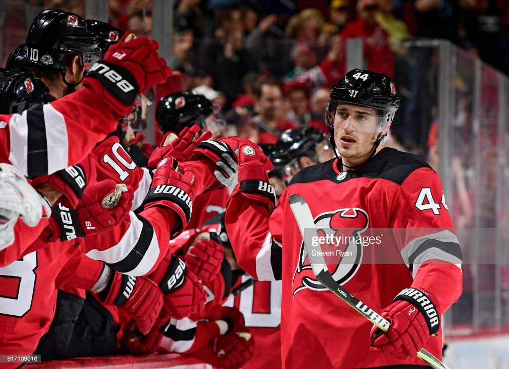 Miles Wood #44 of the New Jersey Devils is congratulated by his teammates after scoring a first period goal against the Boston Bruins at Prudential Center on February 11, 2018 in Newark, New Jersey.