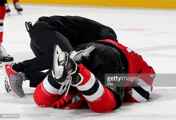 Miles Wood of the New Jersey Devils lies on the ice after getting hit in the face in the second period against the Dallas Stars on December 15 2017...