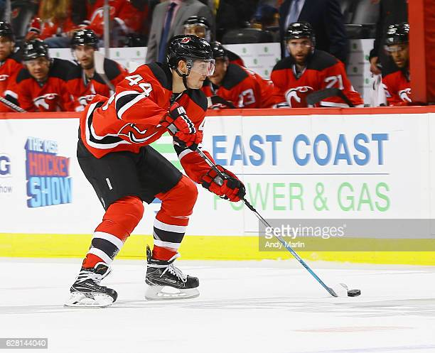 Miles Wood of the New Jersey Devils plays the puck against the Vancouver Canucks during the game at Prudential Center on December 6 2016 in Newark...