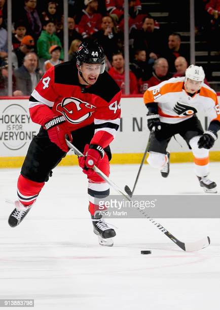 Miles Wood of the New Jersey Devils plays the puck during the game against the Philadelphia Flyers at Prudential Center on February 1 2018 in Newark...