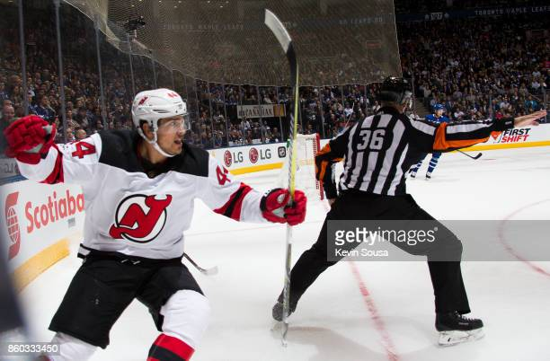 Miles Wood of the New Jersey Devils reacts after scoring g on the Toronto Maple Leafs during the first period at the Air Canada Centre on October 11...
