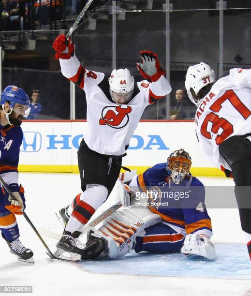 Miles Wood of the New Jersey Devils scores at 241 of the third period against Jaroslav Halak of the New York Islanders at the Barclays Center on...