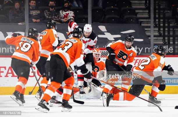 Miles Wood of the New Jersey Devils screens Brian Elliott of the Philadelphia Flyers as the Flyers defend the net at the Wells Fargo Center on May...