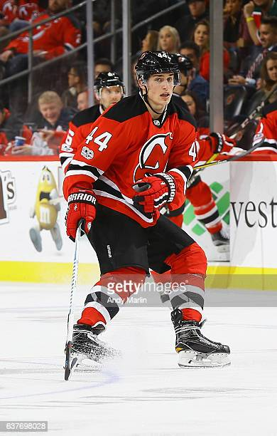 Miles Wood of the New Jersey Devils skates against the Boston Bruins during the game at Prudential Center on January 2 2017 in Newark New Jersey