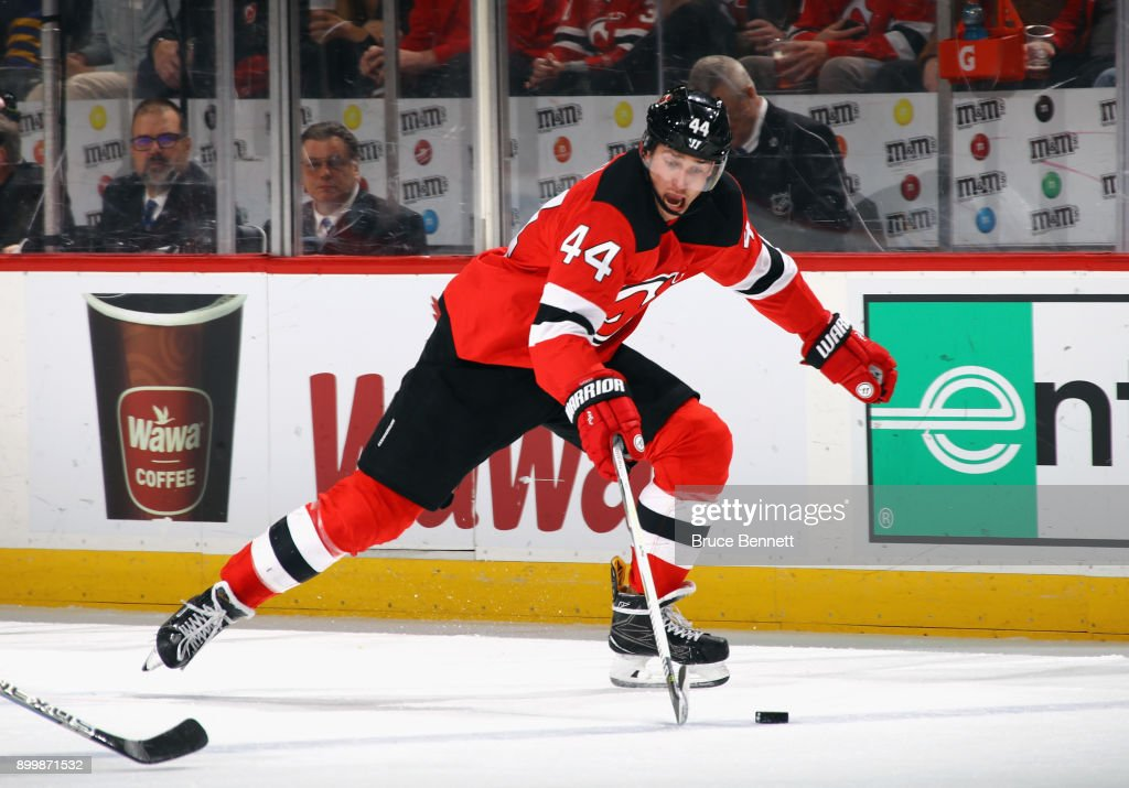 size 40 8554c 12971 Miles Wood of the New Jersey Devils skates against the ...