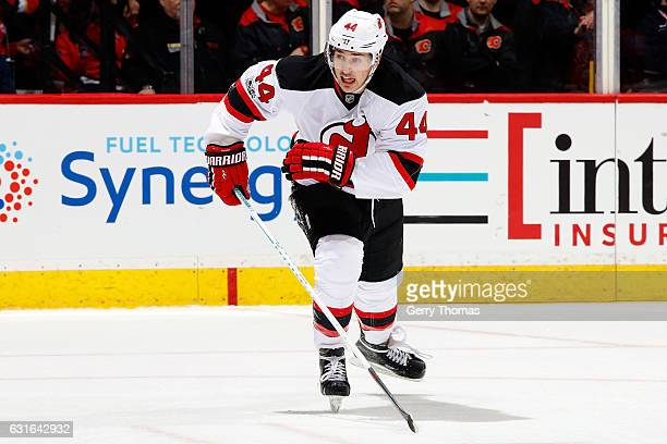 Miles Wood of the New Jersey Devils skates against the Calgary Flames during an NHL game on January 13 2017 at the Scotiabank Saddledome in Calgary...