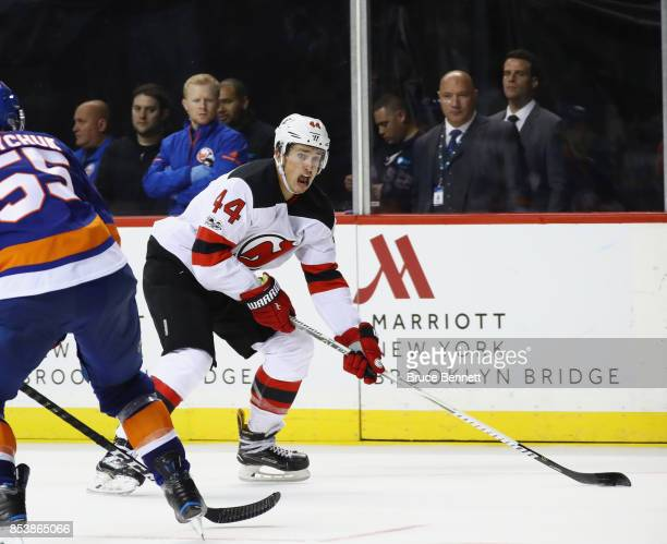 Miles Wood of the New Jersey Devils skates against the New York Islanders during a preseason game at the Barclays Center on September 25 2017 in the...