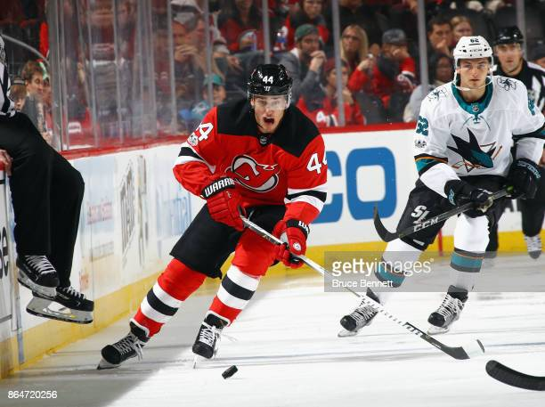 Miles Wood of the New Jersey Devils skates against the San Jose Sharks at the Prudential Center on October 20 2017 in Newark New Jersey The Sharks...