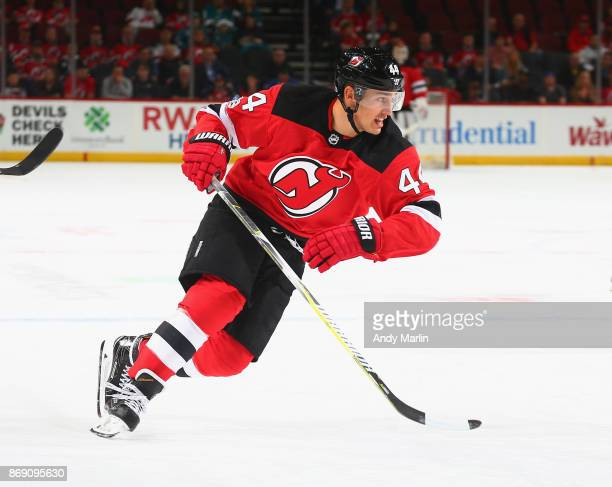 Miles Wood of the New Jersey Devils skates against the San Jose Sharks during the game at Prudential Center on October 20 2017 in Newark New Jersey