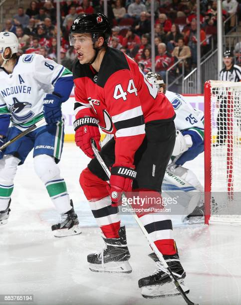 Miles Wood of the New Jersey Devils skates during the second period against Vancouver Canucks on November 24 2017 at the Prudential Center in Newark...