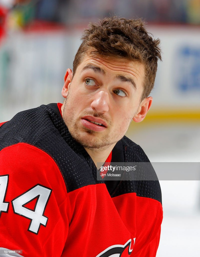 sports shoes 7ce4d 9c014 Miles Wood of the New Jersey Devils warms up before a game ...