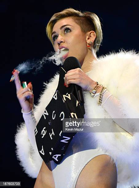 Miley Cyrus accepts award onstage during the MTV EMA's 2013 at the Ziggo Dome on November 10 2013 in Amsterdam Netherlands