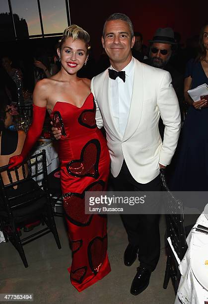 Miley Cyrus and Andy Cohen attend the 2015 amfAR Inspiration Gala New York at Spring Studios on June 16 2015 in New York City