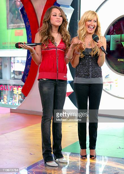 Miley Cyrus and Ashley Tisdale during Ashley Tisdale and Miley Cyprus Visit MTV's 'TRL' June 20 2006 at MTV Studios Times Square in New York City New...