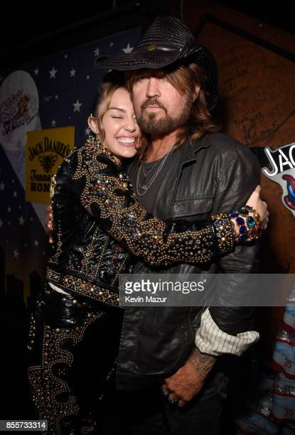 Miley Cyrus and Billy Ray Cyrus attend a welcome home party for Miley Cyrus and her fans to celebrate her new album 'Younger Now' hosted by Spotify...
