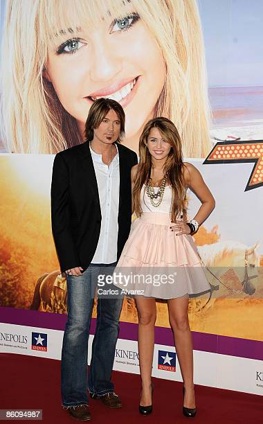 Miley Cyrus and Billy Ray Cyrus attend Hannah MontanaThe Movie premiere at the Kinepolis cinema on April 21 2009 in Madrid Spain