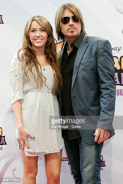 "Miley Cyrus and Billy Ray Cyrus attend the premiere of ""Hannah Montana: The Movie"" in Munich."