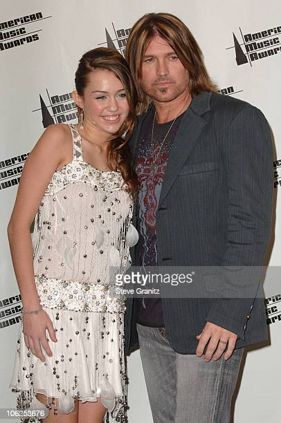 Miley Cyrus and Billy Ray Cyrus presenters during 2006 American Music Awards Press Room in Los Angeles California United States