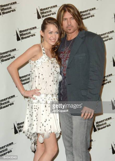 Miley Cyrus and Billy Ray Cyrus presenters during 2006 American Music Awards Press Room at Shrine Auditorium in Los Angeles CA United States