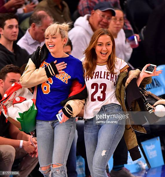 Miley Cyrus and Brandi Cyrus attend the Cleveland Cavaliers vs New York Knicks game at Madison Square Garden on March 26 2016 in New York City