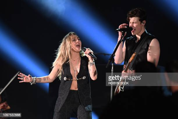 Miley Cyrus and Canadian singersongwriter Shawn Mendes peform during the 61st Annual Grammy Awards on February 10 in Los Angeles