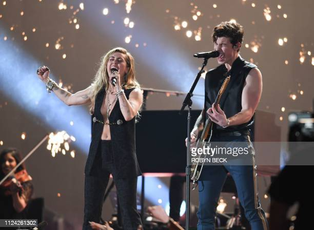 Miley Cyrus and Canadian singersongwriter Shawn Mendes peform during the 61st Annual Grammy Awards on February 10 at the Staples Center in Los...