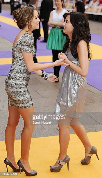Miley Cyrus and Demi Lovato arrive at the UK film premiere of 'Hannah Montana The Movie' held at the Odeon Leicester Square on April 23 2009 in...