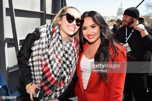 Miley Cyrus and Demi Lovato attend March For Our Lives on March 24 2018 in Washington DC
