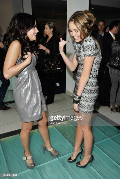Miley Cyrus and Demi Lovato talk ahead of the UK Film Premiere of 'Hannah Montana The Movie' at the Odeon Leicester Square on April 23 2009 in London...