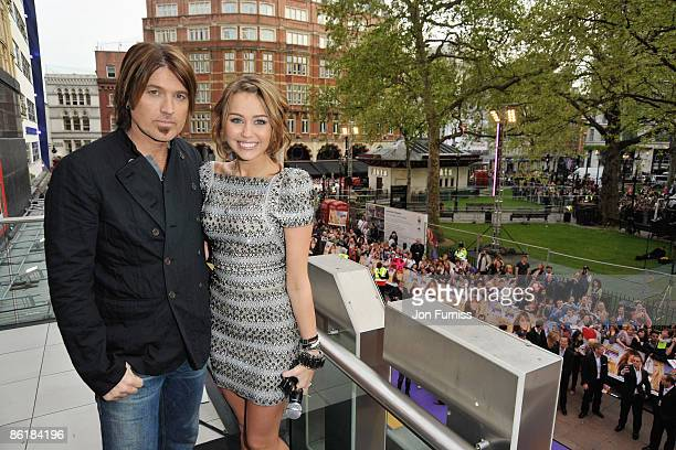 Miley Cyrus and father Billy Ray Cyrus pose at the UK Film Premiere of 'Hannah Montana The Movie' at the Odeon Leicester Square on April 23 2009 in...