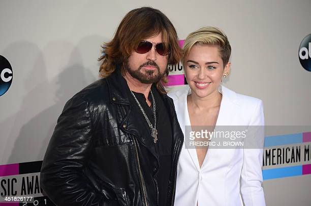 Miley Cyrus and her father Billy Ray Cyrus arrive for the 2013 American Music Awards at the Nokia Theatre LA Live in downtown Los Angeles California...