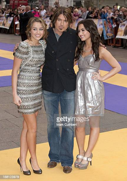Miley Cyrus And Her Father Billy Ray Cyrus With Demi Lovato Arriving At The Uk Film Premiere Of 'Hannah Montana' At The Odeon Leicester Square London