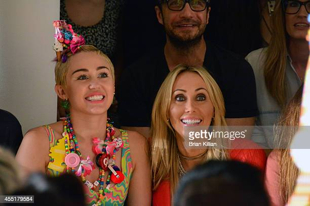 Miley Cyrus and her mother Tish Cyrus attend Jeremy Scott from front row during MADE Fashion Week Spring 2015 at Milk Studios on September 10, 2014...