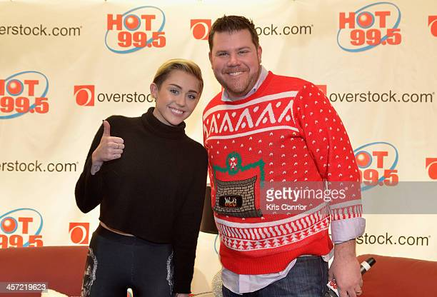Miley Cyrus and Hot 99.5's Kane pose backstage at Hot 99.5's Jingle Ball 2013, presented by Overstock.com, at Verizon Center on December 16, 2013 in...