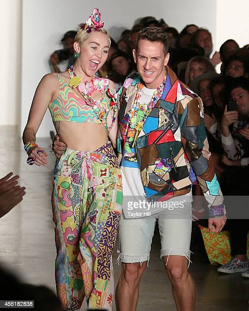 Miley Cyrus and Jeremy Scott walk the runway during the Jeremy Scott show at MercedesBenz Fashion Week Spring 2015 at Spring Studios on September 10...