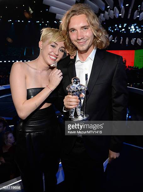 Miley Cyrus and Jesse Helt attend the 2014 MTV Video Music Awards at The Forum on August 24 2014 in Inglewood California