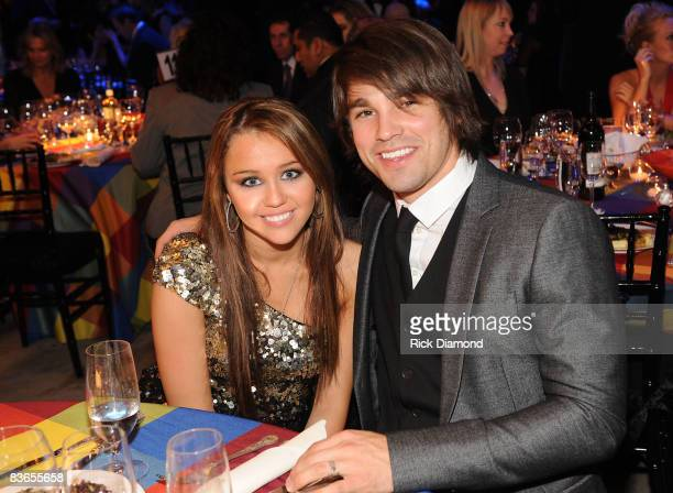 Miley Cyrus and Justin Gaston attends the 56th Annual BMI Country Awards at The BMI Building on November 11 2008 in Nashville Tennessee